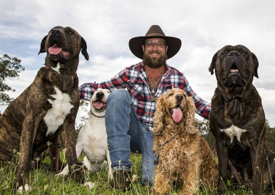 Motley crew: Bear Hasofer aka Bear the Dog Behaviourist with Bull, Bindie, Odie and Ollie, at his Ebenezer farm where he performs obedience and behavioural training. Picture: Geoff Jones