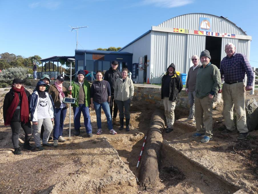 The Flinders University Archaeology team with the excavated log at the American River wharf and hosts from the Rebuild Independence Group on Kangaroo Island.