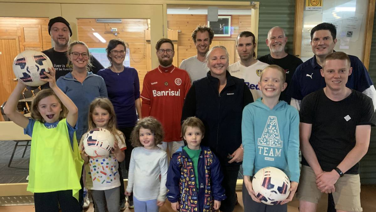 NEW CLUB: Mr Football Shane Smith and Paul from FFSA with the other new KI soccer club members at their home base at The Shed at American River.