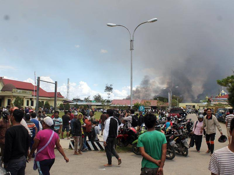 Officials say the death toll has risen to 27 in unrest in Indonesia's Papua province.