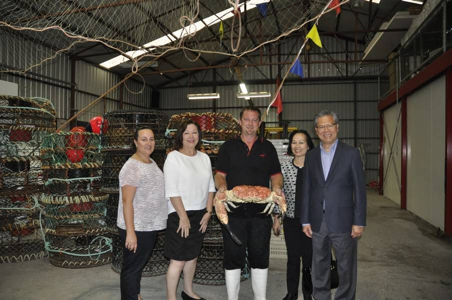 Jason Stevens (centre) showing the Governor and Mrs Le a King Crab, watched by Allison Warner (Fergusons) (far left) and Debra Ferguson, principal Ferguson Australia.